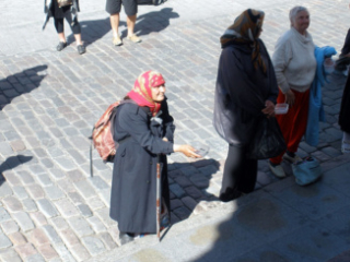 Russian women begging for spare change.