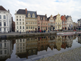 Picturesque medieval buildings in Korenmarkt on the River Leie