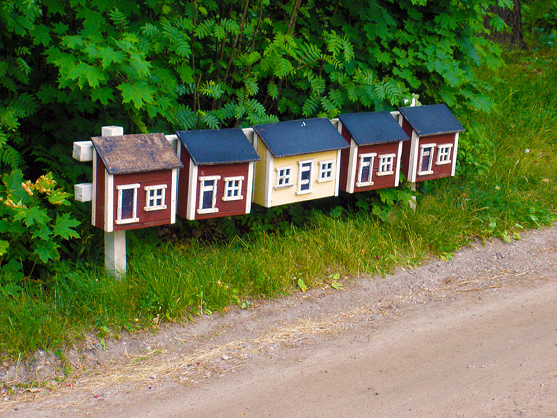 Mailboxes painted in the traditional Finnish colors