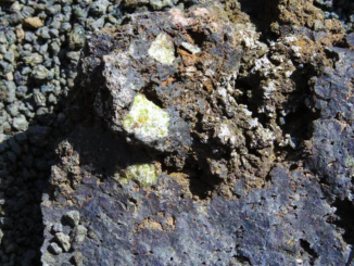 Green crystals forming on the crater rock.