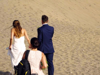 Wedding couple capturing photos at the dunes.