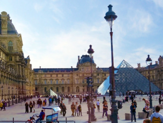 The front of the Louvre showing only a small portion of the vast complex of buildings.