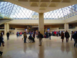 The lobby of the Louvre below the glass pyramid.