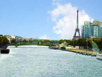 A nice view of the Seine River, the Paris business district, and the Eiffel Tower.