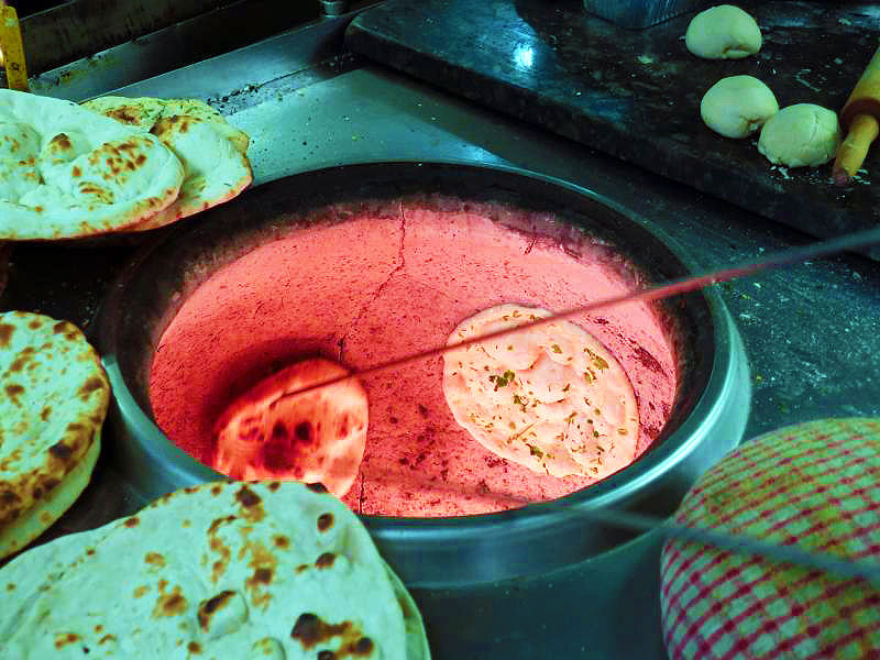 Naan preparation in Clay Oven