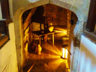 Sub-cellar where other items were stored for meals