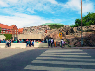 The entrance to the Temppeliaukio or Rock Church with the copper roof visible above the rock wall