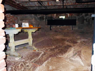 Group cell in the basement that was used as an overflow area.  The prisoners may have stayed here up to 3 or 4 days.