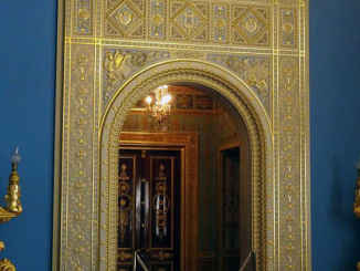 The incredibly ornate doorway leading to the upper level of the theater.