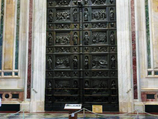 The interior of the massive bronze door at the front of the cathedral