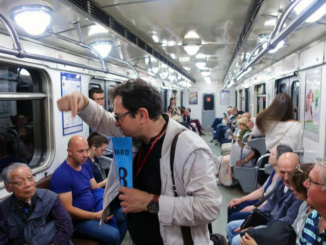 Inside one of the subway cars with our tour guide and may locals