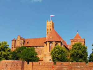 Approaching the main entrance to Malbork Castle showcasing the influence of the Teutonic Order as warrior monks