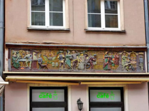 The facade on this establishment depicts the life of the people of Gdansk in the 16th century.