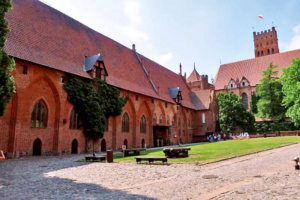 Malbork Castle courtyard where the Gothic style of the fortress shines through.