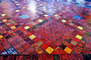 The tile floors are very colorful and you can see part of the Roman style floor heating system in the upper right corner of the picture.