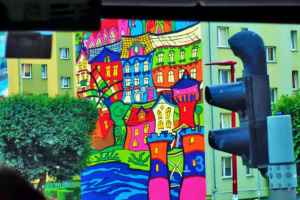 Colorful artwork helping to soften the basic block apartment buildings